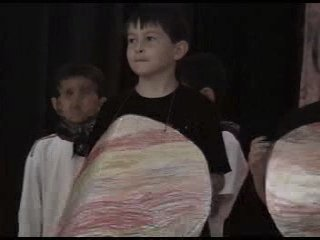 "Matthew as one of the moons of Jupiter in his school play, ""Vacation on Mars"""